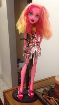Monster high doll with stand and clothes North Vancouver, V7N