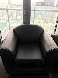 Black artificial leather sofa chair