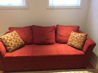 red fabric 2-seat sofa with throw pillows