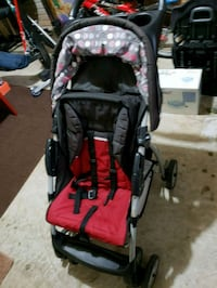 baby's black and red stroller 24 km
