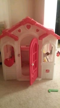 Toy house,  kid size step 2  house. its 55.5 Inches tall inside.