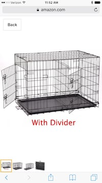 Black pet crate with divier