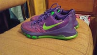 pair of purple and green Nike running shoes