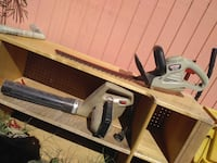 gray Craftsman hedge trimmer and gray leaf blower