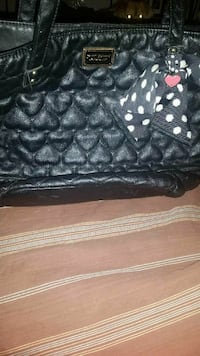 heart-quilted black leather handbag