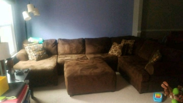 Brown sectional sofa with throw pillows