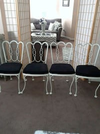 four black metal framed chairs Winthrop, 02152