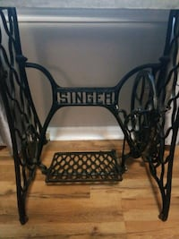 Singer sewing machine stand with marble top