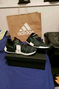 pair of black adidas NMD shoes with box 3664 km