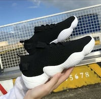 pair of black-and-white Nike Huarache Washington