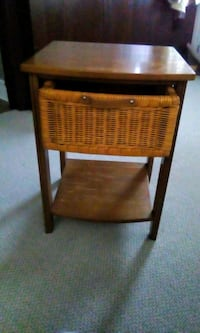Table with wicker drawer oak finish and lower shel Saint Thomas, N5P 3M7