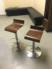 two stainless steel and brown bar stools Surrey, V3W