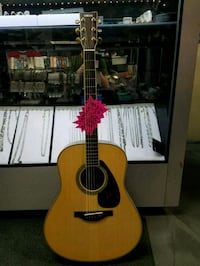 brown and black acoustic guitar Brampton, L6X 1M8