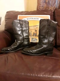 pair of brown leather cowboy boots Highlands, 77562
