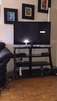 black flat screen TV with black TV stand Toronto, M9P 2K8