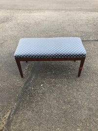 brown wooden bench with blue pad 65 km