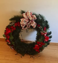 3 foot wreath decorated with lights.