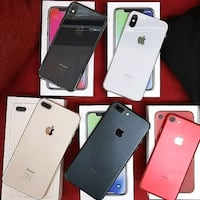 several assorted-color iPhone with boxes United States
