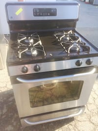 silver GE gas range oven