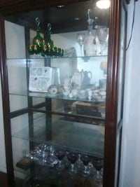 brown wooden framed glass display cabinet Houston, 77083