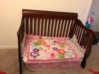 Brown wooden crib with pink floral mattress Fairfax, 22035