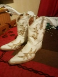 pair of white-and-brown leather cowboy boots Midland, 79706