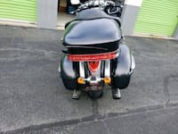 black and red motor scooter 8 mi