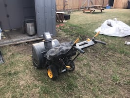 Black and gray snow blower