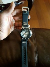 round silver chronograph watch with black strap 547 km