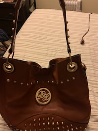 Brown leather bag with inside removable pouch