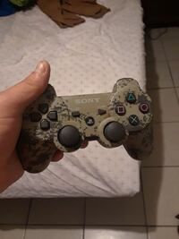 brown and black Sony PS3 controller Deer Park, 77536