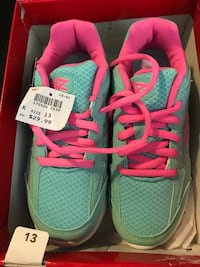 teal-and-pink low-top running shoes with box