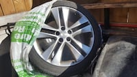 chrome multi-spoke car wheel with tire Toronto, M8W 4X6