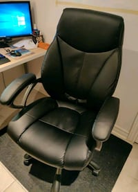 black leather padded rolling chair Toronto, M4M 1V7