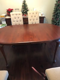 Wood dinning table. In great condition and has been in a smoke free environment. Includes 2 leaves and table top protector. Chairs not included Springfield, 22153