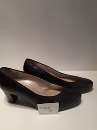 size 7 pair of black leather kitten heels Mount Forest, N0G 2L3