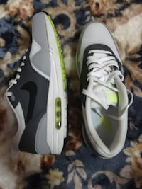 pair of white-and-black Nike sneakers
