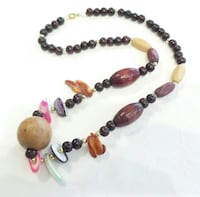 20 Inches in lenth of wood designed beads London