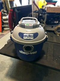 blue and white Shop-Vac vacuum cleaner
