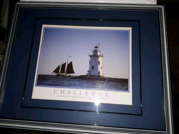 Challenge lighthouse beside sailboat photo