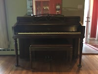 Black and brown wooden upright piano East Meadow, 11554