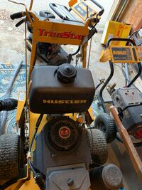 black and yellow Generac pressure washer 994 mi