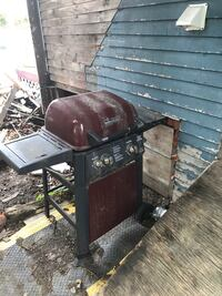 Brinkmann gas grill and propane tank and utensils
