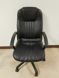 black leather padded rolling armchair Atascocita