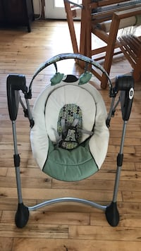 baby's black and gray portable swing
