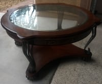round brown wooden framed glass top coffee table Las Vegas, 89178