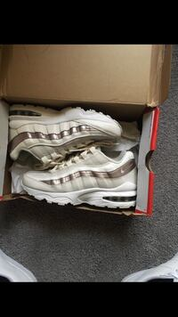 pair of white-and-gray Nike running shoes Hazelwood, 63042