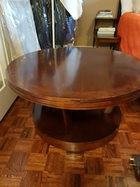 round brown wooden pedestal table Vaughan