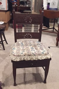 Antique wooden chair with cushion.