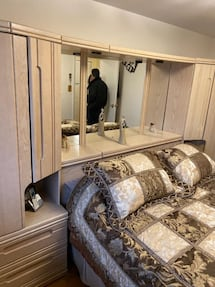 Queen bed mirror wall and dresser